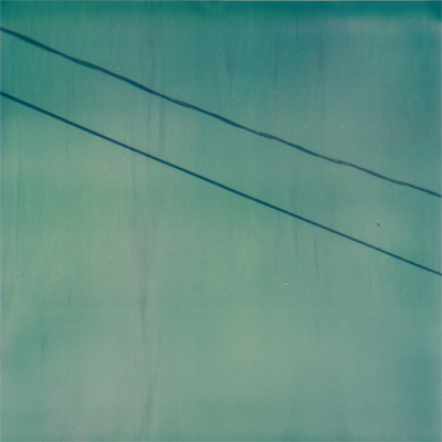 robin's egg blue sky with wires