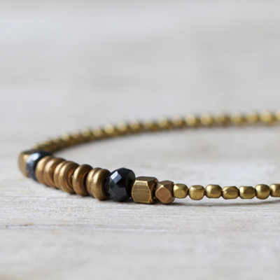 etsy : filoe :  brass beaded bracelet: brass discs and black spinel beaded bracelet