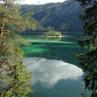 the eibsee is crystal clear, and the colors reflecting from the sky and surrounding trees are insane.