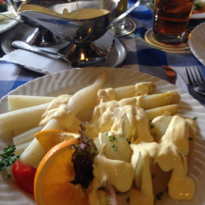 my last dinner was at gastof stern in mittenwald: white asparagus and boiled potatoes smothered in hollandaise sauce (and beer). my fitbit said i walked 18.94 miles that day, so calories were not a concern.